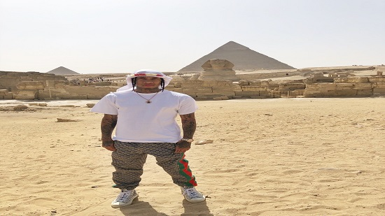 American rapper Tyga poses in front of Egypt's Great Pyramids