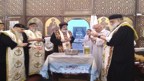 Bishop of Qubba Gardens perfumes the remains of St. Demiana in Waily