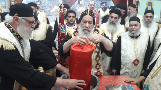 Bishop of Qena perfumes the remains of St. Moussa the Black on his feast