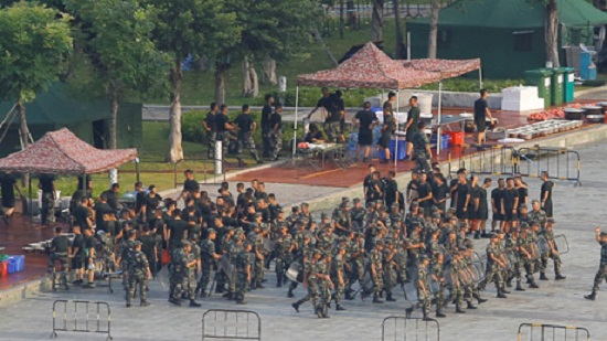 Chinese forces exercise across border as Hong Kong braces for protests