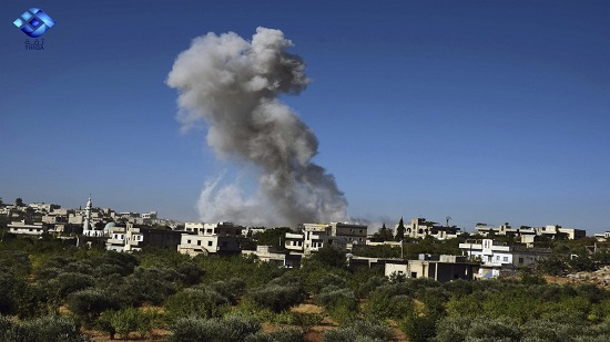 Syria activists: Strikes kill 4 including woman her child