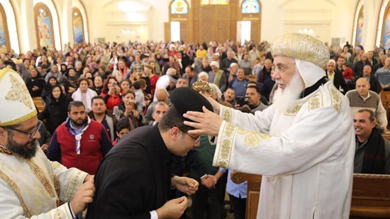 Bishop Pfnotious ordains a new priest in Samalout