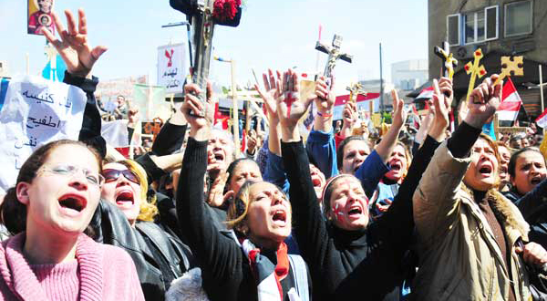 Copts in talks with army as thousands join Maspero protest