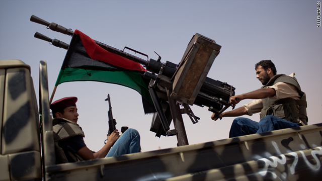 Libyan fighters positioned outside of Gadhafi strongholds
